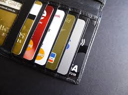 Open wallet showing an array of credit cards in their wallet slots