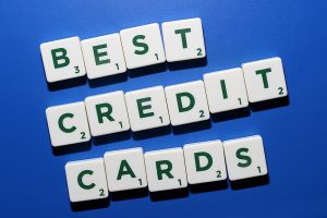 best credit cards in green letters spelled out on white scrabble blocks with a blue background