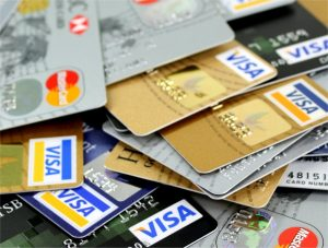 multiple credit cards fanned out and laying on top of one another